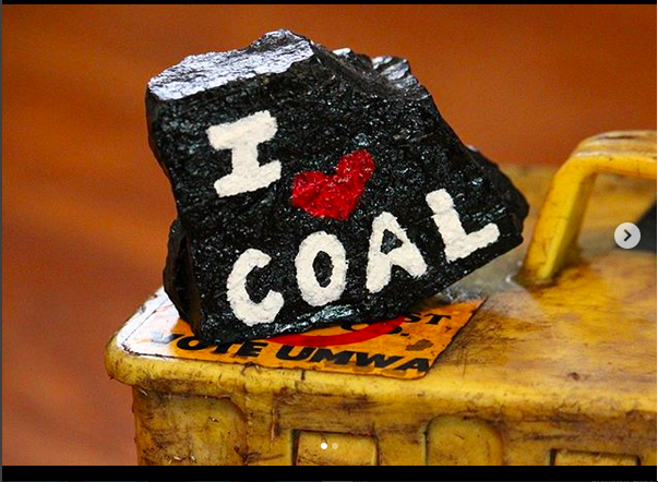 rock with 'I love coal' painted on its side