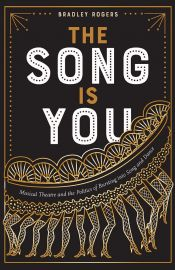 Book cover of THIS SONG IS YOU: book title in gold and white type, over graphical image of chorus line dfancers
