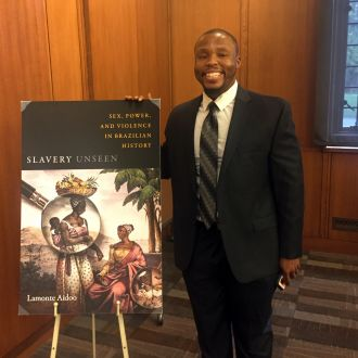 Lamonte Aidoo poses with his book cover