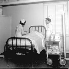nurses near patient bed in hospital archive photo