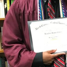 person holds college diploma