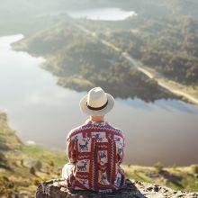 man sitting on mountain