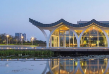 Photo of modern glass building on artificial lake on Duke Kunshan University campus