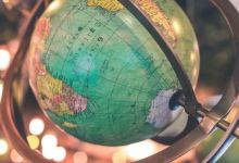 globe on gyre, mirror image with Africa on left, South Africa on right