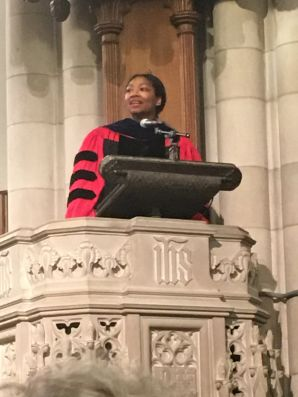 female preacher at pulpit at Duke Chapel